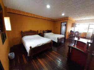 A bed or beds in a room at Hotel El Eden Country