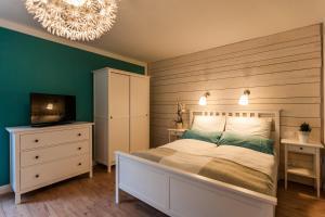Ein Bett oder Betten in einem Zimmer der Unterkunft Haus am See B&B