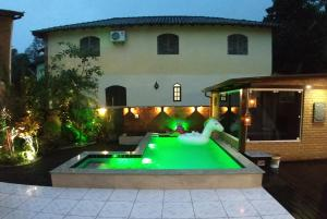 The swimming pool at or close to Portal Suites Casa do Lago
