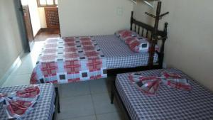 Cama ou camas em um quarto em Pousada Recanto dos Amigos