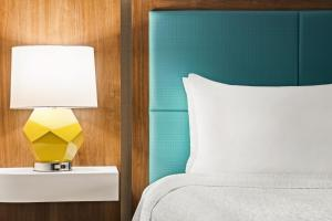 A bed or beds in a room at Hampton Inn Portland Airport