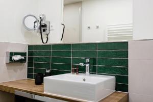 Ein Badezimmer in der Unterkunft Hotel Restaurant Zwergschlösschen