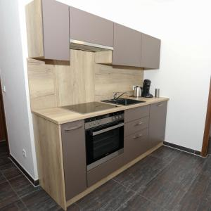 A kitchen or kitchenette at @home Boardinghouse