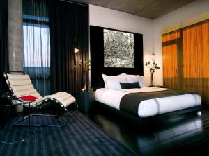 A bed or beds in a room at Sixty LES
