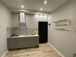 A kitchen or kitchenette at ApartHotel Riga