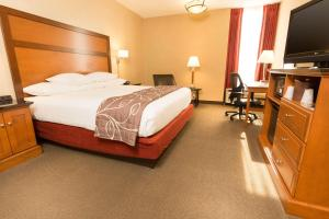 A bed or beds in a room at Drury Inn & Suites Springfield MO