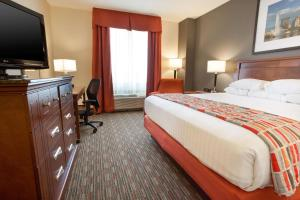 A bed or beds in a room at Drury Inn & Suites Dayton North