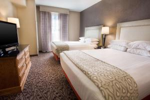 A bed or beds in a room at Drury Inn & Suites Amarillo