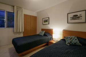 Cama o camas de una habitación en Apartamentos West End