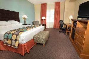 A bed or beds in a room at Drury Plaza Hotel San Antonio North Stone Oak
