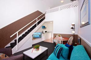 A seating area at Merimbula Sea Spray Motel - Adults Only