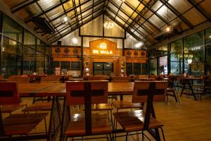 A restaurant or other place to eat at De MALA