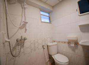 A bathroom at By PJ House