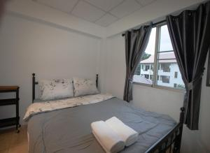 A bed or beds in a room at By PJ House