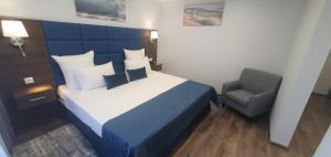 Кровать или кровати в номере Hotel Orbital