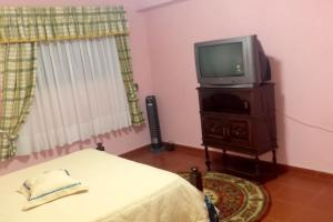 A television and/or entertainment center at House with 2 bedrooms in Palmela 8 km from the beach