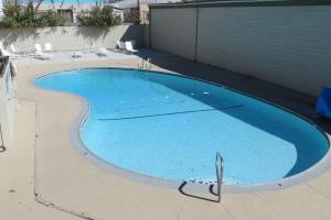 The swimming pool at or near American Inn Stockton