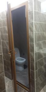 Um banheiro em Senani Villas