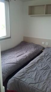 Un ou plusieurs lits dans un hébergement de l'établissement luminosa
