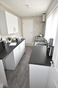 A kitchen or kitchenette at Townhouse @ Penkhull New Road Stoke