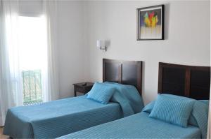 Een bed of bedden in een kamer bij Hotel Central Boutique
