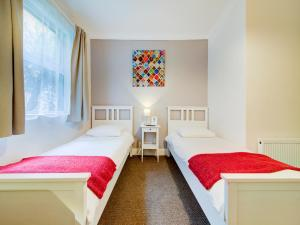 A bed or beds in a room at The Regent Guest House