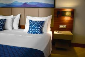 A bed or beds in a room at TUI BLUE Grand Azur