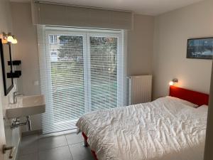 Ein Bett oder Betten in einem Zimmer der Unterkunft Residentie Week-end Elisalaan