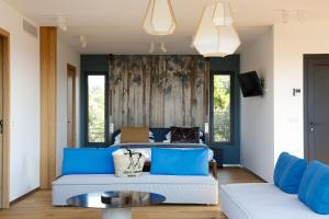 Un ou plusieurs lits dans un hébergement de l'établissement Hôtel & Spa Version Maquis Citadelle