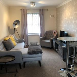 A seating area at Exquisite Apartment Hessle