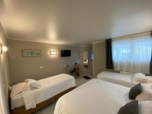 Cama o camas de una habitación en Contact hôtel - Motel Les Bleuets