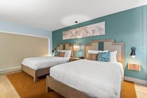 A bed or beds in a room at The Beachcomber St. Pete Beach Resort & Hotel