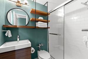 A bathroom at The Beachcomber St. Pete Beach Resort & Hotel