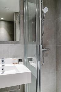 Een badkamer bij Hotel Monasterium PoortAckere