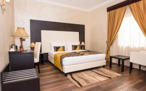 A bed or beds in a room at Akayet Hotel