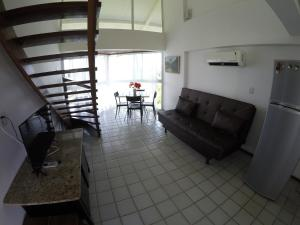 A seating area at Flat Ancorar Porto de Galinhas