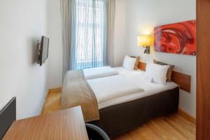 Кровать или кровати в номере Scandic Webers