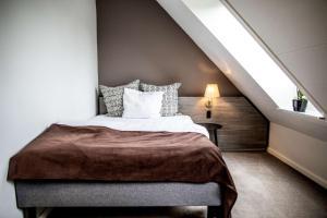 En eller flere senge i et værelse på Scandic Bygholm Park
