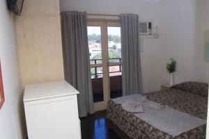 Cama ou camas em um quarto em Hotel Portal das Aguas