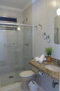 Um banheiro em Hotel Portal das Aguas