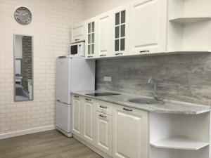 Кухня или мини-кухня в Бридж Хаус Отель Сочи