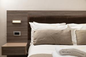 A bed or beds in a room at Royal Sun