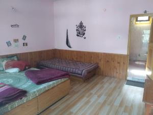 A bed or beds in a room at Joshi's homestay