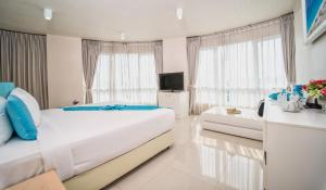 A bed or beds in a room at Royal Pavilion Hua Hin