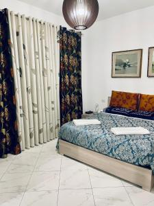 A bed or beds in a room at CASA DEI FIORI