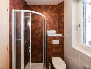 Een badkamer bij Hotel Appartement Haus Gitschberg