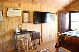 A television and/or entertainment center at Sky Eco - Glacier General Store and Cabins