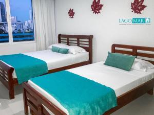 A bed or beds in a room at Lago y Mar Apartamentos
