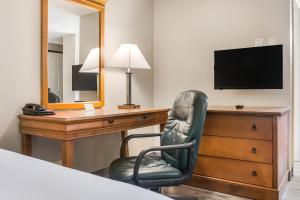 A television and/or entertainment center at Americas Best Value Inn - Lebanon