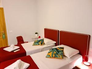 Un ou plusieurs lits dans un hébergement de l'établissement I Dormienti